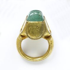 Ring; Italy, circa 1450-1500, gilt bronze set with a green paste, cusped shoulders