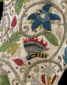 Detail of embroidered jacket, made in England, 1600-25 (source).