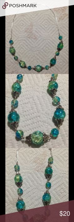 """Blue and Green Glass Bead Silver Necklace This lovely necklace is made with sparkling blue and green glass beads. The chain is sterling silver and attaches with a toggle clasp. This piece measures 16"""" total. All PeaceFrog jewelry items are made by me! Take a look through my boutique for coordinating jewelry and more unique creations. PeaceFrog Jewelry Necklaces"""