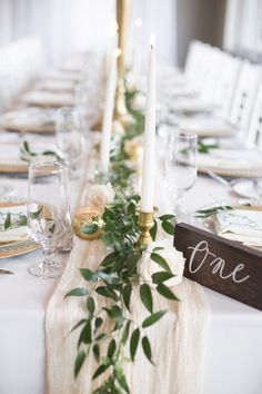 centrepiece-greenery-garland-ruscus-gold-candle-holders-tapered-candles-che/ - The world's most private search engine Simple Wedding Centerpieces, Flower Centerpieces, Wedding Decorations, Centerpiece Ideas, Wedding Ideas, Italian Centerpieces, Long Table Centerpieces, Diy Wedding, Wedding Cake