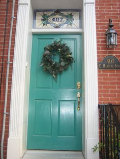front door. Love the teal with the brick.