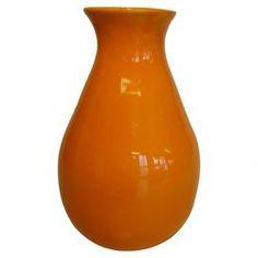 "Tangerine glazed ceramic bud vase.  Product: VaseConstruction Material: CeramicColor: TangerineFeatures:  Vibrant glazeMade in the USA Dimensions: 6"" H x 4"" Diameter"