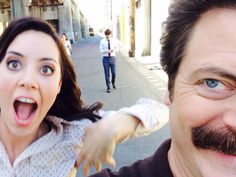 Aubrey Plaza and Nick Offerman who play April Ludgate and Ron Swanson from Parks and Rec with Adam Scott (Ben Wyatt) in the background Parks And Rec Memes, Parks And Recreation, Parks And Rec Cast, Parcs And Rec, Netflix, Nick Offerman, Parks Department, Aubrey Plaza, Celebs