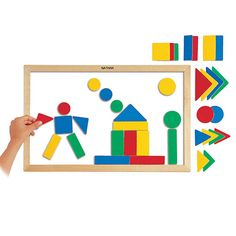 Magnetic Board and Shapes - A wooden framed magnetic board with 38 multi-coloured diversely shaped wooden magnets fantastic for children creating their first mosaics.