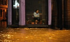 A woman sits inside a Chinese restaurant