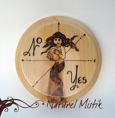 A young mermaid turns her gaze upon you. This is a yes/no pendulum board. The design was drawn freehand and woodburned onto the pine board. It was finished with two coats of water-based varnish. Buy it now on Etsy, Pendulum Board, Pine Boards, Right Brain, Pyrography, Wiccan, The Little Mermaid, Religion, Spirituality, Objects