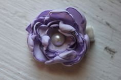 mini lilac hand singed, hand sewn satin rose with faux pearl center