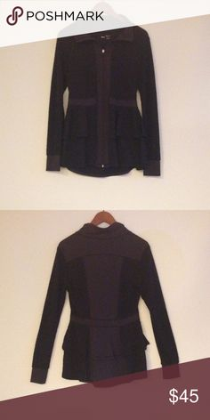 Tonic Sport Jacket Size L Black sport jacket with lower frills. Made thoughtfully in Canada by Tonic. Size Large. In good condition with no stains, holes, or tears. Perfect for the gym, an evening walk at the beach, or a cozy night in town! Tonic Jackets & Coats