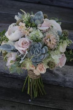 A shabby chic bridal bouquet featuring succulents, dusty pink roses and peonies for a rustic wedding. | Twisted Willow Flowers in New Jersey #weddings #wedding #marriage #weddingdress #weddinggown #ballgowns #ladies #woman #women #beautifuldress #newlyweds #proposal #shopping #engagement