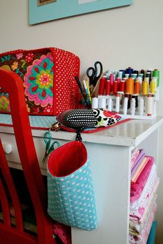 Cute idea for scissors and bag for thread/strings. Also like the mat under the sewing machine that matches.
