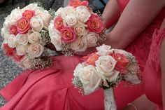 Coral and Ivory Wedding Bouquets.... Looks like there's like a crystal or a pearl in some of them blooms... Very nice touch