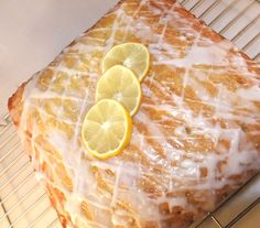 This is a really simple, really easy but REALLY tasty Lemon Drizzle cake. It was baked for a school cake sale: a ten inch square tray bake, sliced into cup-of-tea sized pieces. It has two finishi… Lemon Drizzle Traybake, Lemon Drizzle Cake, Lemon Icing, Lemon Cakes, Damien Rice, Mary Berry, Tray Bake Recipes, Baking Recipes, Cake Recipes