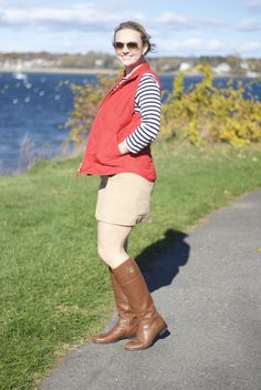 A preppy fall outfit with a red JCrew vest, Tory Burch riding boots and a striped top. Plus a KJP necklace!