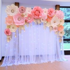 Giant paper flower set to cover 6 ft long backdrop. White roses