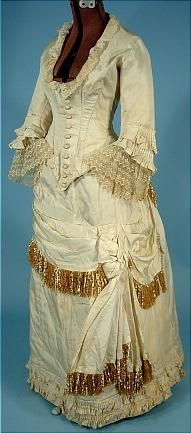 Late 1870s one-piece wedding gown of Ivory Silk Faille with Two-Tone Silk and Chenille Fringe!