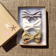 Navy pinstripe, textured floral and winter white hair bows from seaside sparrow. on Etsy, $11.00