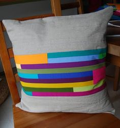 quilted pillow. bright colors and simple lines.