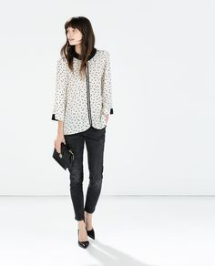 I love polka dots. And I wouldn't normally go for something like this, especially since it's white, but I like that it's unusual for me. The other details are nice. I like this look as a whole.