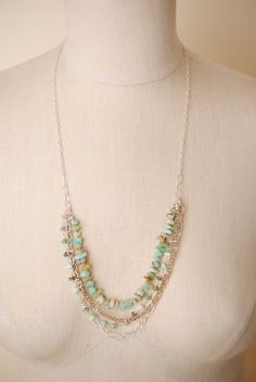 This unique handmade artisan gemstone multi strand necklace for women features Peruvian Opal, agate and other gemstones on sterling silver.   Featured gemstones in three layers, it is long and can be