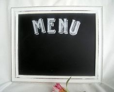 Stunning Shabby Chic Distressed White Frame Sign with a Chalkboard Interior Durable Distressed, White Washed Wood Frame Horizontal or Portrait Style...as the Back Stand on the back can be hung either way Removable Chalkboard to Insert Your Own Sign Stunning Shabby Chic