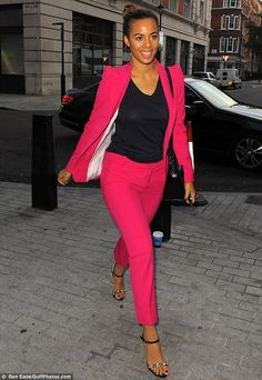 Pretty in pink! Rochelle Humes looked bright and breezy in spite of her crack of dawn wake-up call as she arrived at the Radio 1 studios in ...