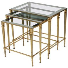 French Brass Nest of Tables with Glass Tops | From a unique collection of antique and modern nesting tables and stacking tables at https://www.1stdibs.com/furniture/tables/nesting-tables-stacking-tables/