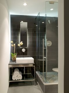 Black and White Modern Bathroom...nice continuation of tile from shower to sink area