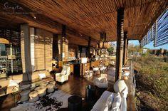 A early morning sunrise beams through Singita Lebombo Lodge.