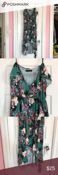 Plus Size Floral Dress NWOT. Tried on once. Cold Shoulder dress. Cross cross front effect giving it a high low look. There is a tie belt included. Size 1X from from Fashion to Figure. Fashion to Figure Dresses High Low
