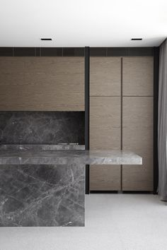 Kitchen at Canterbury Road Residence in Toorak designed by B.E Architecture in darker tones of tan and brown