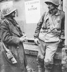 Wearied GIs trapped inside the Belgian town of Bastogne during the Battle of the Bulge  United States Army Photograph