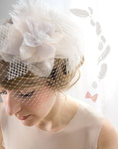 Bridal birdcage veil - Mini Hat - 1920's inspired feather fascinator. $145.00, via Etsy.