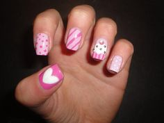 Yummy, creamy and delicious pink white candies and cupcakes on nails