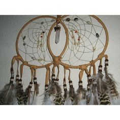 Brown Wolf Double Dreamcatcher with fancy feathers and native woven... ($69) ❤ liked on Polyvore featuring home and home decor