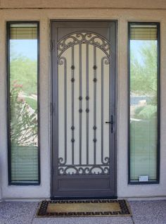 Custom wrought iron security screen doors, or storm doors, of the highest quality. Contact First Impression Ironworks today for an in-home appointment Doors, Security Screen Door, Screen Door, Wrought Iron Security Doors, Security Storm Doors, Door Awnings, Steel Doors, Elegant Doors, Iron Security Doors