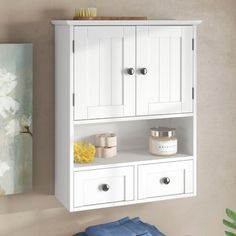 Charm and practicality come together in perfect harmony with this wall cabinet. It adds storage to any space with its 2 Nantucket-style doors and two pullout drawers, along with its open display shelf. It's perfect for the bathroom and beyond. Cabinet Shelving, Shoe Storage Cabinet, Toilet Storage, Storage Cabinets, Bath Storage, Cupboards, Bamboo Cabinets, Wall Mounted Bathroom Cabinets, Bathroom Shelves