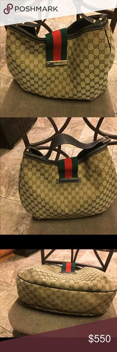 """AUTHENTIC GUCCI HOBO AUTHENTIC GUCCI GG Large canvas hobo. Comes with dust bag. Price is NOT negotiable. She's a beauty!!  17""""w x 12""""l. Has very little wear on corners shown in pics. Traditional red& green flap that is magnetized. Gucci Bags Hobos"""