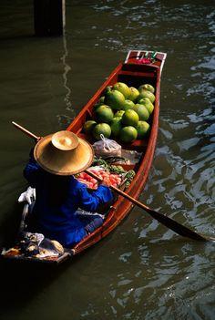 Boat carrying produce at the Floating Market, Damnoen Saduak (near Bangkok), Thailand   Blaine Harrington Photography