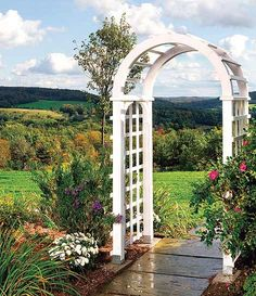 The obvious way to define your yard is to put up a fence. The cool way is to forget the fence and just build a gateway -- a portal from here to there that implies a change of space without presentin...