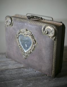 ~ Victorian Photo Album With Heart Shaped Mirror ~I have this with my relatives photos but min has maroon brocade that has not faded