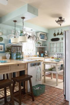 House of Turquoise: Susan Gilmore    Inspiration: light fixtures, pot rack, and shelves (less the brackets)