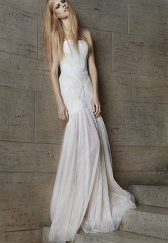 Look 10. Ivory and nude strapless hand draped tulle mermaid gown.