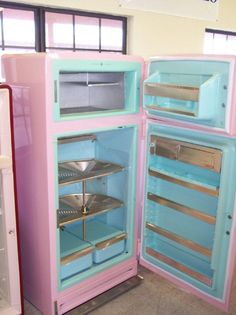 50s vintage pink refrigerator with a turquoise interior