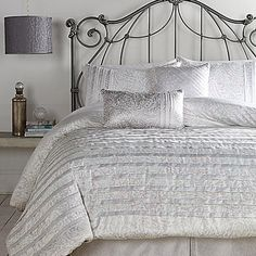 Transform your bedroom into a serene sanctuary with the beautiful Jessica Simpson Ethereal Pleats Comforter Set. Dressed in a subtle paisley print and pleated design in hues of white, grey and silver, the stylish bedding adds a lavish look to any room.