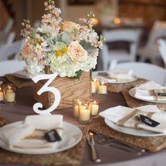 peach peonies, lamb's ear, hydrangeas and craspedia filled white ceramic vases.