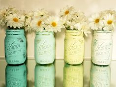 I love Daisys, i love jars...perfect centre pieces :)