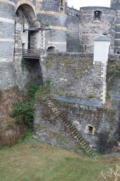 Chateau D'Angers. Medieval Castle with a drawbridge and a Moat. France. stairway to moat