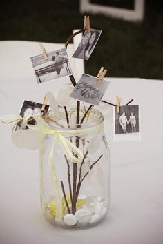 love the tiny clothespined photos- i would use a much nicer container tho!
