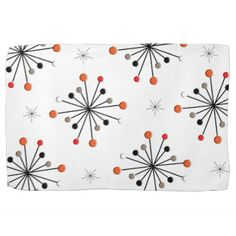 A fabulous retro inspired funky modern pattern of star bursts with atomic spheres in shades of orange, grey, black and white.