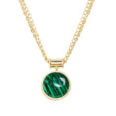 """You'll get lost in the deep emerald and teal layers of the Dawn malachite pendant necklace. This beautiful piece is the utmost in class, perfect for daytime and evening wear.    - Gold plated, malachite  - 24"""" long  - Slip-on"""